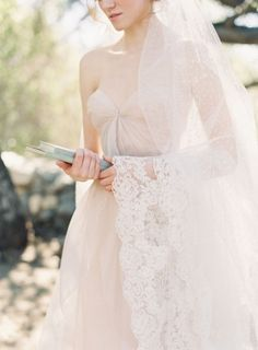 Sheer Lace Trimmed Mantilla Veil   from SIBO   photography by http://www.carolinetran.net/
