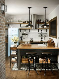 Small Industrial Kitchen Design Layout With Wood Island And Floating Shelves Featuring Exposed Brick Walls 5 Deadly Mistakes of Small Kitchen Design Homeowners Commonly Make, Small kitchen design plans, Small square kitchen design layout pictures Warm Industrial, Industrial House, Industrial Design, Industrial Apartment, Industrial Kitchens, Industrial Furniture, Industrial Office, Industrial Interiors, Industrial Bookshelf