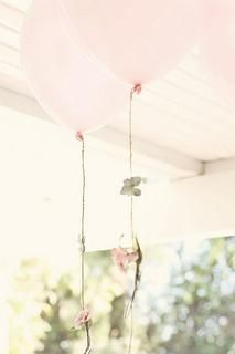 A pretty idea for wedding decorations | add flower garlands to balloons