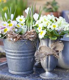 Easter perfect flowers arranged in galvanized containers. #spring #Easter #flowers #garden