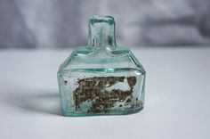 1800s antique aqua sheared lip glass inkwell bottle with pen rest and remains of a makers label