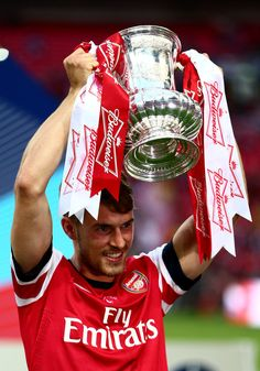 Aaron Ramsey Photos - Aaron Ramsey of Arsenal celebrates victory with the trophy after the FA Cup with Budweiser Final match between Arsenal and Hull City at Wembley Stadium on May 2014 in London, England. - Arsenal v Hull City - FA Cup Final Arsenal Fc, Arsenal Players, Football Is Life, Football Team, Arsenal Football, Arsenal Pictures, Fa Cup Final, Hull City, Great Team