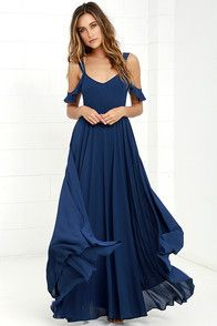 From posh prom or lavish cocktail party, and from sea to shining sea, the Bariano Ocean of Elegance Navy Blue Maxi Dress will have you in the lap of luxury wherever you may go! Navy blue Georgette starts this exquisite ensemble off with tank straps joined by sheer off-the-shoulder straps that support a fitted bodice featuring a plunging sweetheart neckline with elegant ruching details. Additional ruching delicately encircles an empire waistline, while a showstopping floor-length maxi with a…