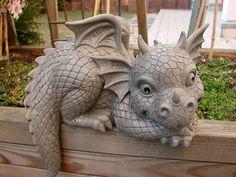 Now I cant decide. Dragon House, Dragon Garden, Dragon Art, Fairy Village, Paper Mache Crafts, Cute Dragons, Green Man, Garden Ornaments, Wood Sculpture
