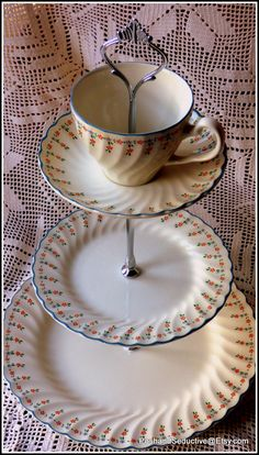 """Three tier cake stand handmade using vintage Johnson Brothers """"Dreamland"""" pattern set of plates """"Alice in Wonderland"""" style tea party chic Johnson Bros china Johnson Brothers three tier cakestand tiered cake stands handmade cake stands Dreamland pattern floral china pattern high quality china Christmas gift idea English bone china Tea time accessories Thanksgiving gift Wedding gifts 45.00 GBP #goriani"""