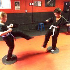 Kerri and Danny on the Balance Discs of Death practicing their Snap Kicks KIAI! #martialarts #karate #judo #jiujitsu #aikido #shorinryu #nagewaza #sparring #kumite #fighting #selfdefense #blocking #punching #striking #kicking #throwing #falls #rolls #mma #campbells #kickboxing #copiague #shihanmike #sensei #sempaisensei