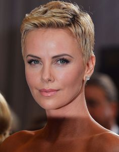 Short Hairstyles Lookbook: Charlize Theron wearing Pixie (45 of 86). Charlize Theron's bottle-blond pixie exuded modern femininity at the 2013 Oscars.