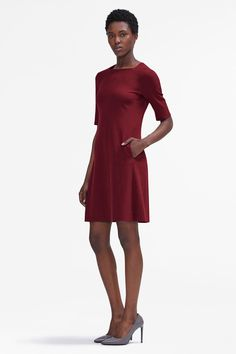 The Emily is unmistakably ladylike but can hold its own in a room full of suits. In addition to its signature square neckline, it has so many of the details you love: elbow-length sleeves, useful pockets, and a flattering A-line skirt.