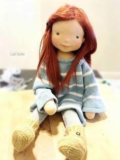 Noor wearing her cozy boots, made by Jennifer Williams at Lali Dolls