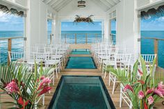 An over-the-water wedding chapel! Can you picture yourself walking down this aisle for your destination wedding? Via #WeddingMoons by @SandalsResorts.