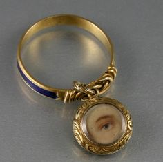 VICTORIAN GOLD & BLUE GUILLOCHE ENAMEL LOVERS KNOT RING WITH EYE MINIATURE PAINTING