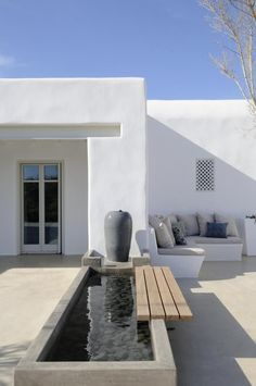 Raised pond and built-in bench pool backyard Luxury villa escape to the sultry island of Paros Outdoor Spaces, Outdoor Living, Outdoor Patios, Outdoor Kitchens, Raised Pond, Raised Planter, Built In Bench, Bench Seat, Terrace Garden