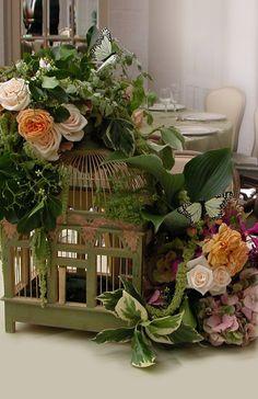 birdcage with silk flowers
