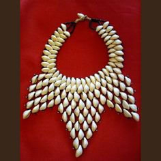 Cowrie Shell Art | Necklace of cowries and braided raffia