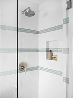 In the new shower stall, porcelain subway tiles and glass accent tiles team up for to-the-ceiling luxury with an easy-clean surface. A built-in niche adds storage for shower products and keeps them off of the floor.  Glass showers make every bathroom look large.