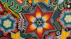 """Huichol Art.... They are created using exclusively Czech PRECIOSA seed beads that are applied usually to wooden, sometimes also to ceramic objects of various sizes and shapes. This are mainly all sorts of animals, but also various decorative boxes, jars, etc. The Huichol apply a thin layer of beeswax to these objects, stick individual seed beads on them and create fairly complicated iridescent patterns that way."