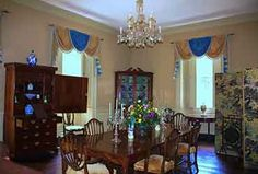 Berkley Plantation, Virginia - The handsome Adam woodwork and the double arches of the 'Great Rooms' in the mansion were installed by Benjamin Harrison VI in 1790 at the  direction of Thomas Jefferson.
