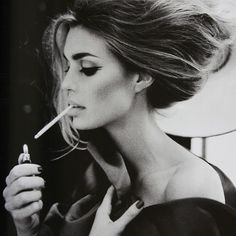 Sexy..... except for the smoking....not so into that....love the long neck and hair and attitude:)