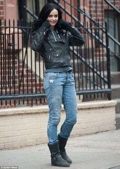 Sexy and dangerous: Krysten Ritter suited up in a leather jacket and ripped jeans as super...