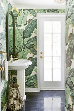 Bathroom with banana leaf print wallpaper