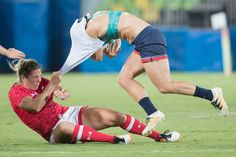 Canada's Kelly Russell takes down Great Britain's Katy McLean on a day in which the Canadian sevens rugby team won over the first ever bronze medal in women's rugby.