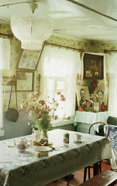Russian folk - Flowers plucked from outside enhance an already bright yet simple dining room.