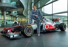 """Formula One ace Jenson Button swapped his fire-resistant driving suit for designer pyjamas today as he called on Londoners to go to work in their nightwear for a """"big sleepover"""" on Red Nose Day. Pajama Day, Thing 1, Male Feet, Formula One, Sleepover, Nightwear, Carry On, Pajamas, Racing"""