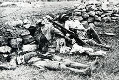Ethiopian soldiers fallen behind a trench. Italo-Ethiopian war, 1935-36. Note the BAR rifle.
