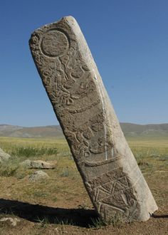Mongolian Deer Stone. Deer stones (also known as reindeer stones) are ancient megaliths carved with symbols that can be found all over the world but are concentrated largely in Siberia and Mongolia and are believed to have originated there. The name comes from their carved depictions of flying deer. Wiki
