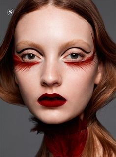 red feather makeup look.. somewhat frightening