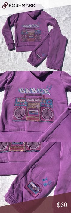 """Super Soft By BUTTER. Purple Bling Set Super Soft by BUTTER. Purple fleece lined  zip- up and sweatpants set. Zip- up jacket has a blinged out radio player and """"DANCE"""" written in the back. Sweatpants has a blinged out cassette and two notes on it. This set is gorgeous and can be worn together or seperately. It is great for back to school. Warm, cosy and very soft. Comes in different sizes. My sizes come in XS Age 3/4; S 5/6, M Age 7/8, Large Age 10/12. Great item to own. Super Soft by Butter…"""