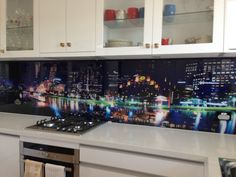 Residential Kitchen - Printed Glass Splashback Multiple Photograph's of The City of Melbourne at night.