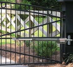 Automatic driveway gates are now being installed in homes of all sizes and price ranges. Find out their benefits, how to install and what gate to buy. Aluminum Driveway Gates, Automatic Gate Opener, Fence Gate, Fencing, Gate Openers, Historic Homes, Stairs, Home Appliances, Outdoor Structures