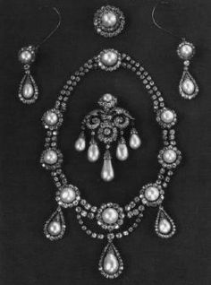The necklace and earrings are a wedding gift from the Khedive Ismail Pasha of Egypt to the future Queen Louise of Denmark in 1869.    The Pins belonged to the grandmother of Queen Louise.