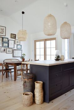 modern kitchen with rattan pendant lights, and navy kitchen island, modern dining room, boho dining room Kitchen Paint, New Kitchen, Kitchen Dining, Kitchen Decor, Kitchen Island, Kitchen Cabinets, Dining Rooms, Dark Cabinets, Kitchen Baskets