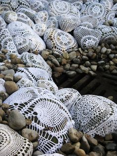 Every single stone has been wrapped  could also be made with cake paper or paint lace on the stones.....  (I absolutely cannot see wrapping stones.  Painted stones is whole other thing though.  Would make a pretty garden border.)