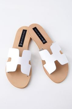 Spend a sunny day exploring Santorini in the Steven by Steve Madden Greece White Leather Slide Sandals! Smooth, genuine leather shapes a wide, toe band with notched detail and side cutouts, creating a simple-yet-stylish look that's perfect for everyday wear. Slide-on design.