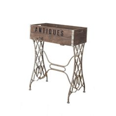 Crate planter table from a shopping site. Imitation can probably be made from an old Singer wrought iron stand and some pallet wood!