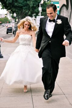 bride and groom running together