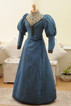 A blue circa 1895 Victorian dress with leg-o-mutton sleeves.