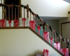 "To go with my PRESENTS Christmas theme this year, I came up with this decoration for my staircase. I love it and It will definitely make a statement with my other ""present"" decorations. Here's how to make it."