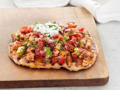 Get this all-star, easy-to-follow Grilled Chicken Taco Pizzas recipe from Aaron McCargo Jr.
