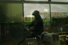 Japanese Taxi Driver Takes Multiple Exposures While Looking for Passengers /12