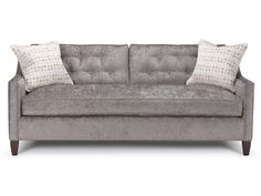 The Newman Collection features clean, modern lines with elegantly sloping track arms, high tapered legs and box back cushions.  Deep two-cushion seating and ample proportions make for an ultra comfortable sofa. The sofa comes with 2 box toss pillows.  Try it with optional buttons.
