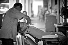 Street barber in Joo Chiat, Singapore