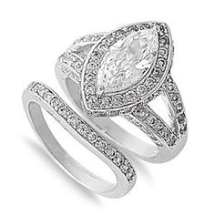 This perfect color, clarity and cut Marquise Cut Halo Russian Lab Diamond Ring is styled with details to sparkle and stay classic through the tests of time. It's a split shank with a perfectly accented wedding band. Russian lab diamonds are. Engagement Sets, Halo Engagement Rings, Diamond Wedding Rings, Wedding Engagement, Wedding Bands, Diamond Rings, Wedding Flowers, Bridal Ring Sets, Bridal Jewelry Sets
