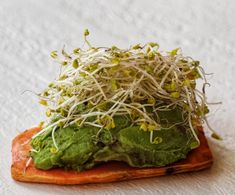 My newest snack obsession with sweet potato toast...piled high with avocado, pink sea salt and sprouts...so good!!! Simply slice the sweet…
