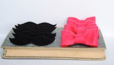 Use Gold sparkly bows and black mustaches for friends to vote girl or boy?