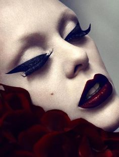 Dramatic winged eye liner and dark red lips