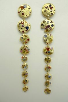 Carousel Earrings. 18K yellow gold with sapphires